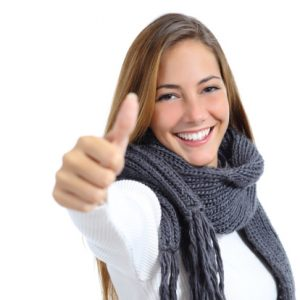 smiling young woman giving the thumbs up sign