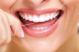 Woman with a beautiful smile who made the decision to floss daily this new year